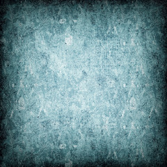 Dark turquoise grunge background. The texture of the old surface. Abstract pattern of cracks, scuffs, dust