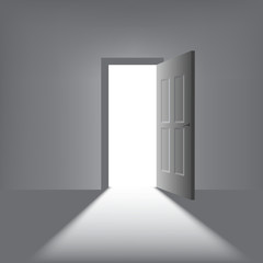 open door with a bright light on a dark background