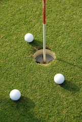 Golf ball close to hole