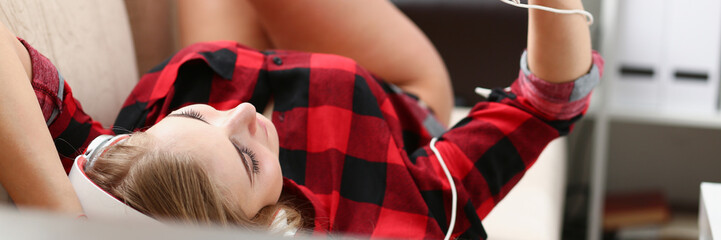 woman listen music lie on sofa