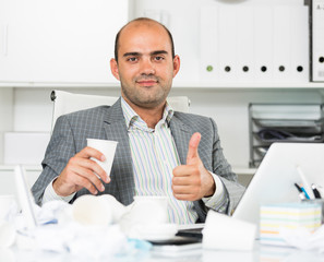 Young cheerful male worker having glad