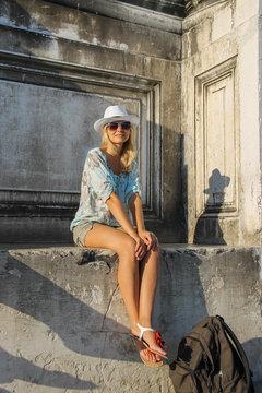 Pretty woman in white hat in Venice, Italy