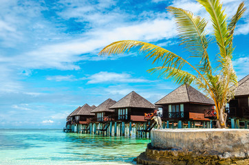 Exotic wooden huts on the water, Maldives