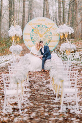 Beautiful happy couple on the wedding ceremony in autumn forest