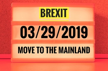 Luminous sign with inscription in english Brexit and 03/29/2019 and move to the mainland, in german 29.03.2019 und zieh aufs Festland, symbolizing the withdrawal of Great Britain from the EU