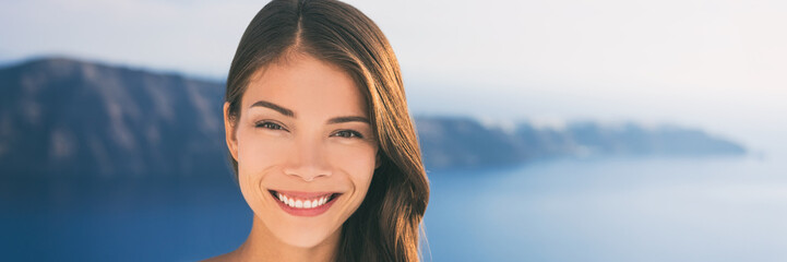 Wall Mural - Asian beauty woman model smiling outside in sun. Portrait of happy girl in her 20s, beautiful multiracial young female, banner panorama.