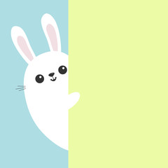 White bunny rabbit holding green wall signboard. Cute cartoon funny animal hiding behind paper. Happy Easter symbol. Peekaboo. Flat design. Pastel blue color background.