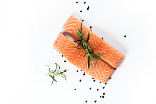 Slices of the fresh salmon on white
