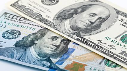 Closeup new and old American money hundred dollar bill. Benjamin Franklin portrait, us 100 dollar banknote fragment macro