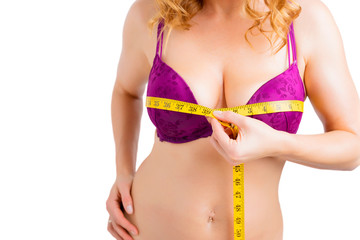 Woman measuring bust size with measurement tape