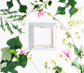 Top view flat lay empty photo frame with summer leaves and daisy flowers mockup. Text space