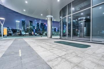 Fotomurales - night view of empty brick floor front of modern building