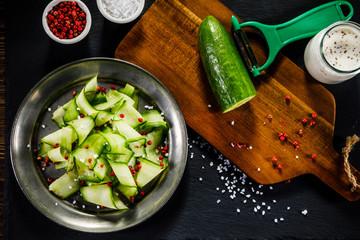 Fresh cucumber on cutting board
