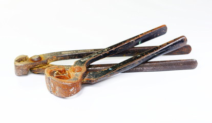 old rusty pliers on white