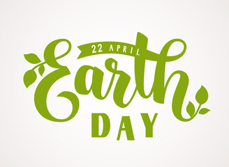 Happy Earth Day. 22 april. Vector hand lettering greeting text with green leaves silhouette