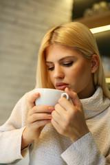 Beautiful woman enjoying in the coffee.