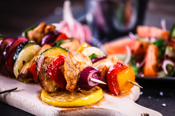 Aluminium Prints Grill / Barbecue Kebabs - grilled meat with vegetables on wooden background