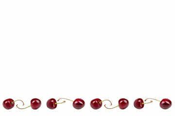 Isolated cherries. Collection of sweet cherry fruits isolated on white background with clipping path. Top view. Berries