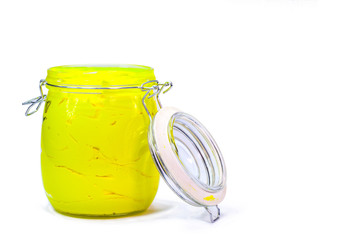 yellow color of plastisol ink in white background fill in transparent bottle.plastisol ink is specially for print on tee shirts and any fabric
