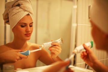 Woman brushing her teeth in the morning.