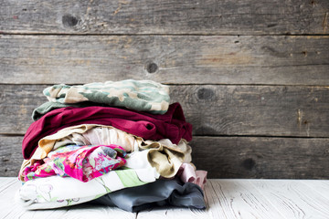 folded clothes on a wooden table