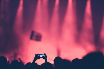 Fan taking photo of concert with a smart phone