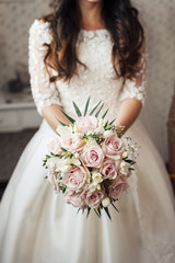 Crop bride with beautiful bouquet