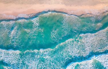 Wall Mural - crashing waves against sand