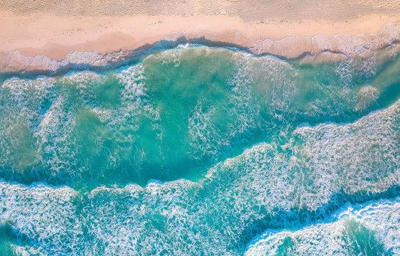 crashing waves against sand