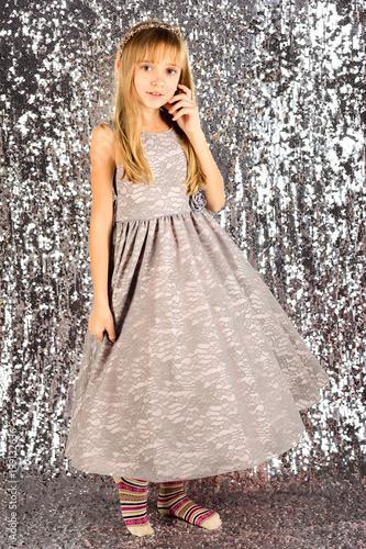 c83aaa0b830f Little girl in fashionable dress, prom. Child girl in stylish glamour dress,  elegance