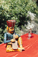 Vintage figurine and flowers in bottle