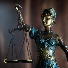 Legal office of lawyer. legal model statue of Themis goddess of justice.
