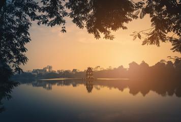 Turtle Tower on Hoan Kiem Lake at sunrise in Hanoi, Vietnam. Vintage tone