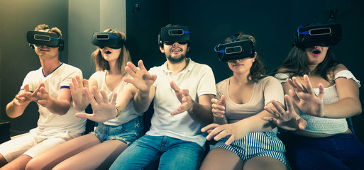 Group of friends  using virtual reality glasses