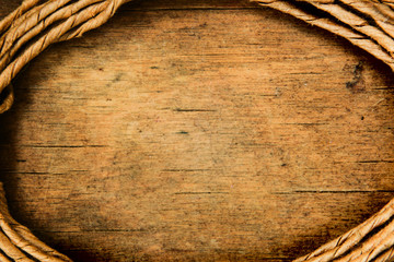 Vintage background with place for text from old rope and wooden surface macro