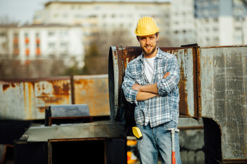strong man, worker on site with helmet on head