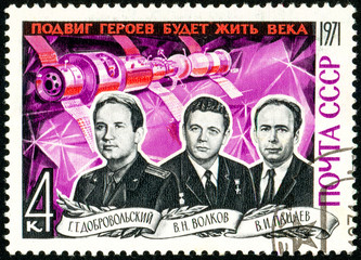 Ukraine - circa 2018: A postage stamp printed in Soviet Union, USSR shows portrait of cosmonauts Dobrovolsky, Volkov, Patsayev. They perished when returning to Earth. Circa 1971