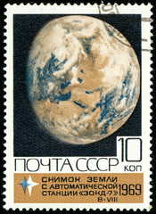 Ukraine - circa 2018: A postage stamp printed in Soviet Union USSR show Snapshot of the Earth from the automatic probe Zond-7. Series: Space Exploration. Circa 1969.