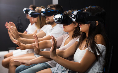 Woman watching exciting movie with VR glasses