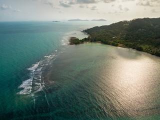 Aerial view of emerald tropical sea and Ko Samui island, Thailand