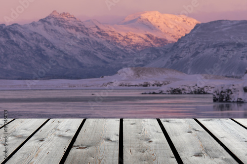 wooden floor with iceland scene and snow mountain and sunrise and