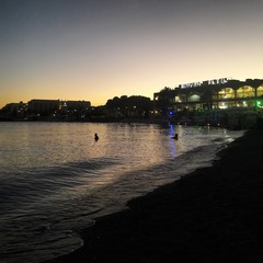 2 people swimming after sunset in Eilat Israel