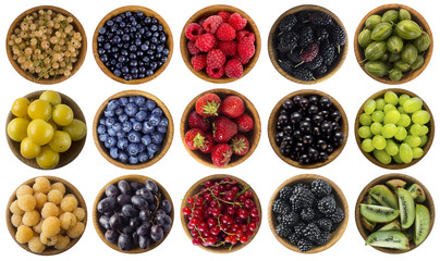 Collage of different colors fruits and berries on a white background. Strawberries, currants, raspberries, yellow plum, blueberries, grapes, blackberries, gooseberries, kiwi, mulberry. Top view.