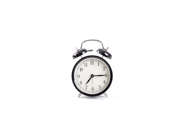 Classic black alarm clock isolated on a white background