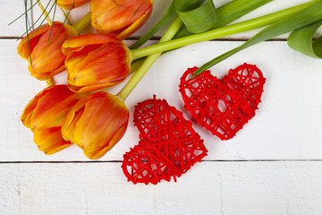 Bouquet of tulips and red hearts