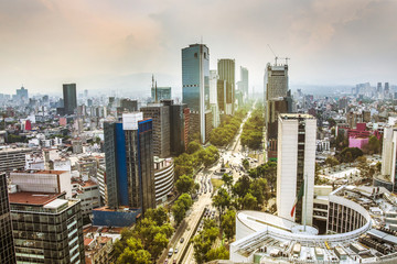 Wall Mural - Skyline in Mexico City, Reforma aerial view at sunset time