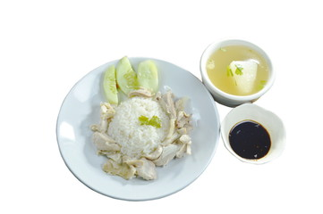 steamed rice topping boiled chicken with sauce and soup
