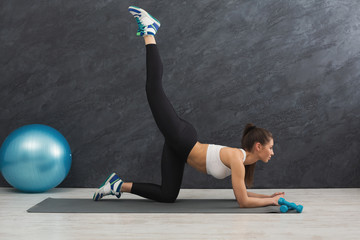 Fitness woman stretching indoors