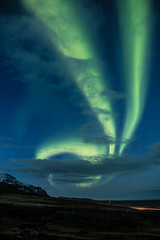 Foto auf Leinwand Violett Northern lights aka Aurora Borealis glowing on the sky with mountains in Iceland