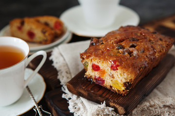 Traditional fruit cake pudding with dried fruits on wooden board